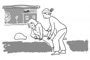 対人介助の仕事で起きあがるのを助ける様子